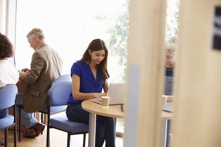 breakout: Mature Students Working In College Breakout Area Stock Photo