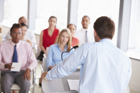 delegates: Business Delegates Listening To Presentation At Conference