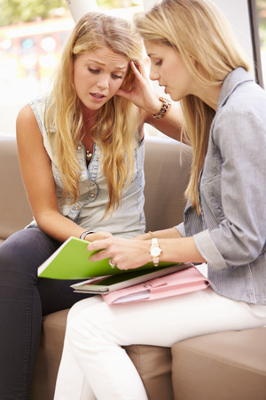 19 years old: Depressed College Student Talking To Counselor Stock Photo
