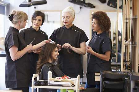 hairdressing: Teacher Training Mature Students In Hairdressing Stock Photo