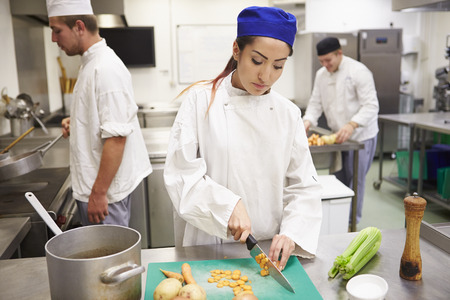Students Training To Work In Catering Industry Banco de Imagens