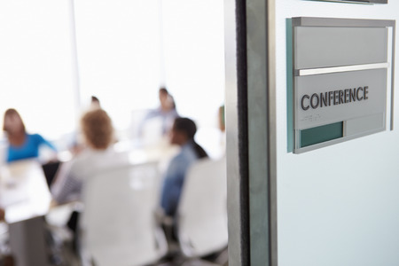 View Through Door Of Conference Room To Business Meeting Stock Photo