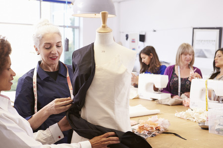 50s fashion: Mature Students Studying Fashion And Design Stock Photo
