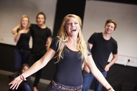 acting: Students Taking Singing Class At Drama College