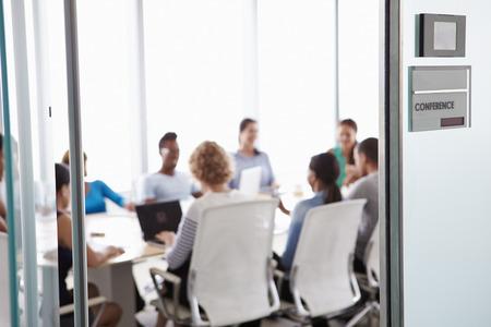 View Through Door Of Conference Room To Business Meeting Standard-Bild