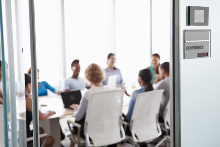 meeting together: View Through Door Of Conference Room To Business Meeting Stock Photo
