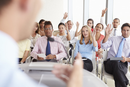questions: Delegates Asking Question At Business Conference Stock Photo