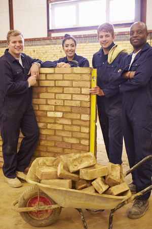 19 years old: Teacher Helping Students Training To Be Builders