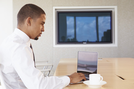 working space: Businessman Having Video Conference In Boardroom