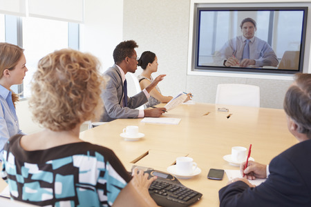video: Group Of Businesspeople Having Video Conference In Boardroom