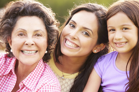 3 generation: Grandmother With Granddaughter And Mother In Park