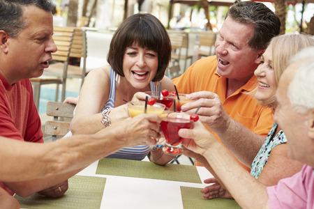 cocktail bar: Group Of Senior Friends Enjoying Cocktails In Bar Together