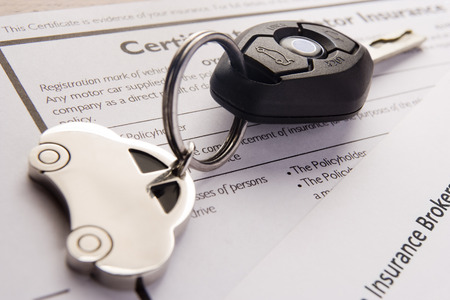 motors: Car Keys And Keyring On Insurance Documents