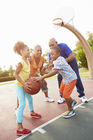 outdoor basketball court: Grandparents And Grandchildren Playing Basketball Together
