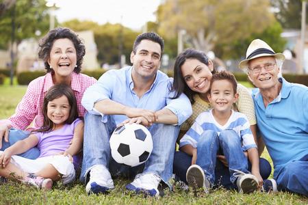 hispanic child: Multi Generation Family Playing Soccer Together