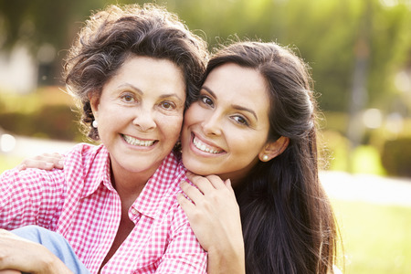 elderly adults: Mother With Adult Daughter In Park Together Stock Photo