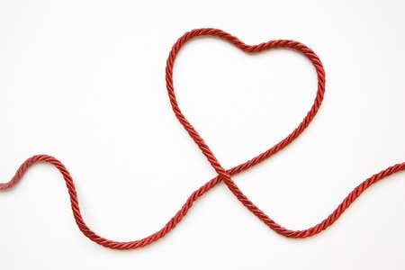 cords: Heart Shape Made From Red Cord On White Background Stock Photo