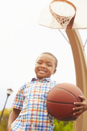 african basket: Portrait Of Boy On Basketball Court