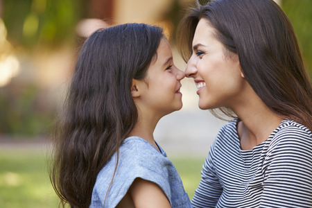 noses: Portrait Of Loving Mother And Daughter In Garden
