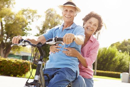 active retirement: Senior Hispanic Couple Riding Bikes In Park