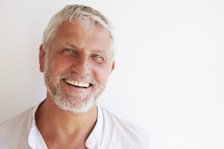 middleaged: Portrait Of Mature Man Standing Against Wall Stock Photo