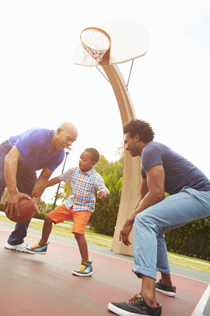3 5 years: Grandfather With Son And Grandson Playing Basketball Stock Photo