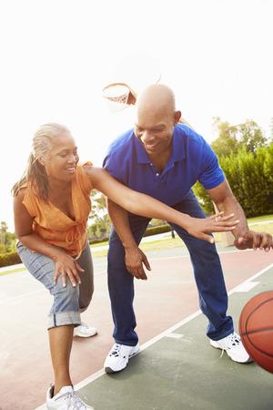 Senior Couple Playing Basketball Together Фото со стока