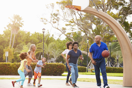 outdoor basketball court: Multi Generation Family Playing Basketball Together