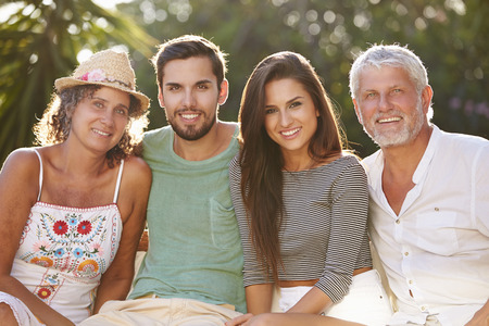 adult offspring: Parents With Adult Offspring Relaxing In Garden Together