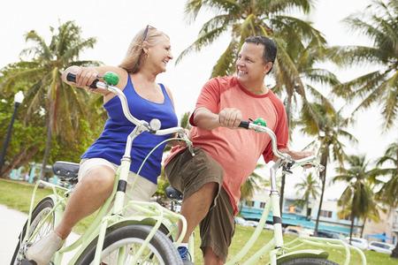 couple having fun: Senior Couple Having Fun On Bicycle Ride