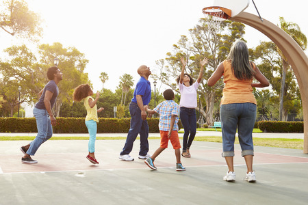 family playing: Multi Generation Family Playing Basketball Together