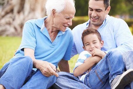 grandson: Grandfather With Grandson And Father In Park