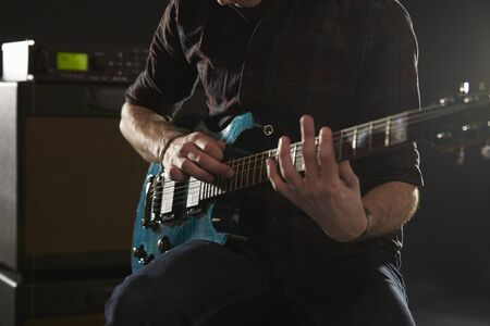 tapping: Close Up Of Man Using Tapping Technique On Electric Guitar