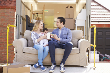 moving van: Family With Sofa On Tail Lift Of Removal Truck Moving Home