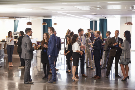 Delegates Networking At Conference Drinks Reception Imagens