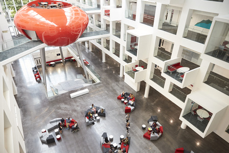 view of an atrium in a building: Modernist interior of a university atrium, elevated view Stock Photo