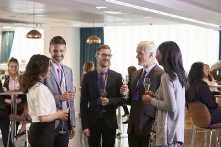 Delegates Networking At Conference Drinks Reception Stockfoto