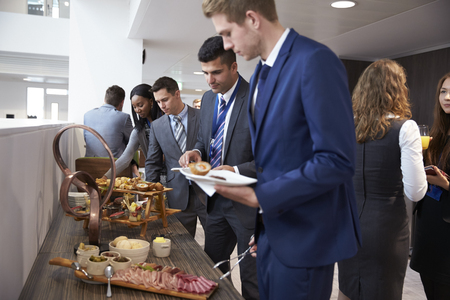 attendee: Delegates At Lunch Buffet During Conference Break