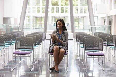 executive women: Businesswoman In Empty Auditorium Preparing To Make Speech