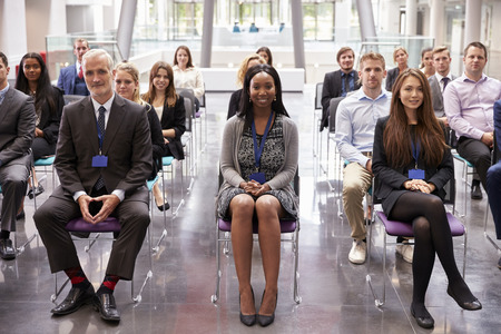 attendee: Audience Listening To  Speaker At Conference Presentation