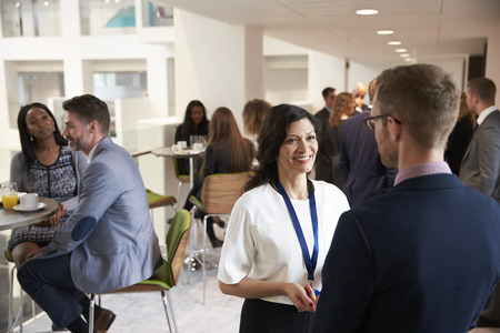 Delegates Networking During Coffee Break At Conference Imagens - 71259026