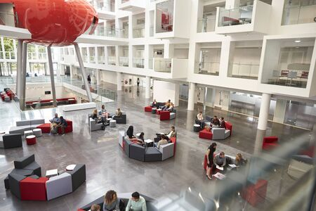 view of an atrium in a building: Students in a modern university atrium, view from mezzanine