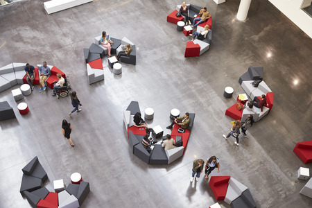 Students in the atrium of modern university, elevated view