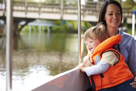 18 30s: Mother And Son Enjoying Day Out In Boat On River Together