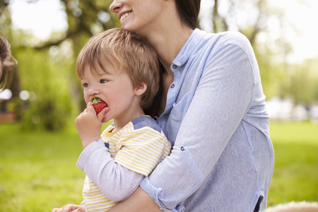 18 30s: Mother And Son Enjoying Riverside Picnic Together Stock Photo
