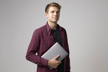 casually: Studio Portrait Of Casually Dressed Businessman With Laptop Stock Photo