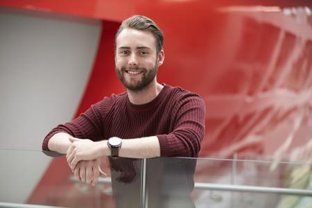 Bearded male student in modern university building, portrait