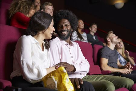 Couple In Cinema Watching Comedy Film Stok Fotoğraf