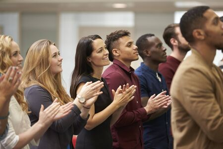 organised: Adult students applauding at an event in their university Stock Photo