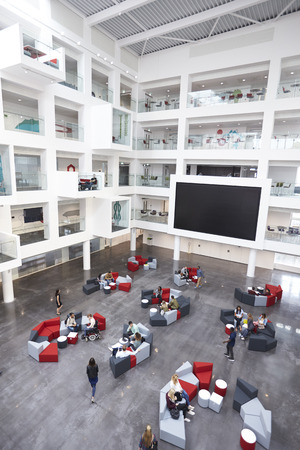 view of an atrium in a building: Modern university lobby atrium and study rooms, vertical Stock Photo